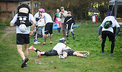 © Licensed to London News Pictures. 08/04/2018. Dorking, UK. A couple collapse at the end of the race. Competitors take part in the 2018 annual Wife Carrying Race in Dorking, Surrey. The race, which is run over a course of 380m, with both men and women carry a 'wife' over obstacles, is believed to have originated in the UK over twelve centuries ago when Viking raiders rampaged into the northeast coast of England carrying off any unwilling local women . Photo credit: Ben Cawthra/LNP