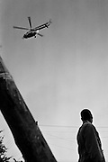 NAIROBI, KENYA - DECEMBER 31, 2007: A helicopter flies over Kibera slum. A surge in violence left scores of people dead in Nairobi as defeated presidential candidate Odinga prepared to declare himself head of state, after rejecting the victory of incumbent president Mwai Kibaki.