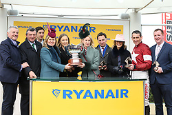 Owner Michael O'Leary (left) and Jockey Davy Russell (second right) collect the trophy after winning the Ryanair Steeple Chase with Balko Des Flos during St Patrick's Thursday of the 2018 Cheltenham Festival at Cheltenham Racecourse.