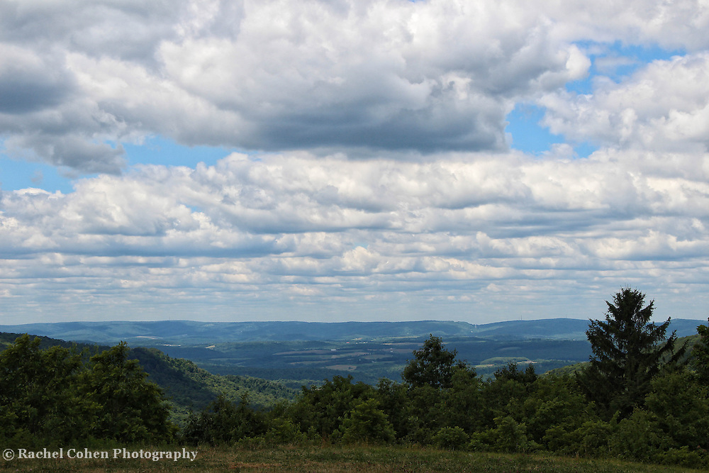"""""""Sky Rolling""""<br /> <br /> From high atop a mountain layers of puffy clouds rolling across the sky, bring dark shadows all through the beautiful Laurel Highland area!!<br /> <br /> Laurel Highlands Area of Pennsylvania by Rachel Cohen"""