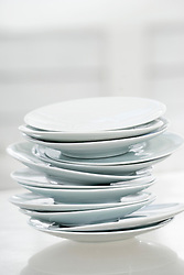 Close-up of stack of white plates, Bavaria, Germany
