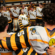 Killer Bees' Dylan Abood, center, leads a profanity-laced taunt towards Odessa following their victory over them in the locker room at the State Farm Arena in Hidalgo. The victory celebration occurs in the locker room after each win.<br /> Nathan Lambrecht/The Monitor