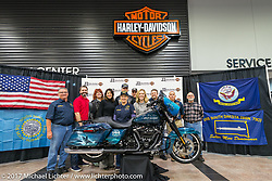 (Left to Right) Jim Entenman, Myrick Robbins, Leah Whaley, Kristi Noem, Debra Bodenstedt, Wiley Cress, Tom Muenster, Mickey Harris, Jeff Alvey and Lonnie Entenman after the unveiling at J and L Harley-Davidson of the 2018 Harley-Davidson Street Glide donated by the Motor Company and customized by J and L to commemorate the christening of the USS South Dakota submarine. Sioux Falls, SD. USA. Monday October 9, 2017. Photography ©2017 Michael Lichter.