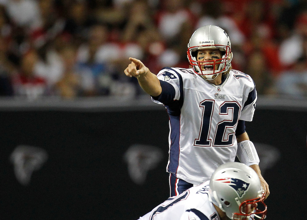 ATLANTA - AUGUST 19:  Quarterback Tom Brady #12 of the New England Patriots points out the defensive alignment during the preseason game against the Atlanta Falcons at the Georgia Dome on August 19, 2010 in Atlanta, Georgia.  (Photo by Mike Zarrilli/Getty Images)