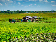 25 NOVEMBER 2017 - YANGON, MYANMAR: A local home seen from the window of the Yangon Circular Train. The Yangon Circular Train is a 45.9-kilometre (28.5 mi) 39-station two track loop system connects satellite towns and suburban areas to downtown. The train was built during the British colonial period, the second track was built in 1954. Trains currently run both directions (clockwise and counter-clockwise) around the city. The trains are the least expensive way to get across Yangon and they are very popular with Yangon's working class. About 100,000 people ride the train every day. A a ticket costs 200 Kyat (about .17¢ US) for the entire 28.5 mile loop.    PHOTO BY JACK KURTZ