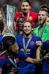 24-05-2017 SWE: Final Europa League AFC Ajax - Manchester United, Stockholm<br /> Finale Europa League tussen Ajax en Manchester United in het Friends Arena te Stockholm / Antonio Valencia(C) #20 of Manchester United met de Europa Cup trophy, Daley Blind #17 of Manchester United