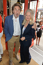 HOWARD JACOBSON and his wife JENNY DE YONG at a party to celebrate the launch of Top Dog at 48 Frith Street, Soho, London on 27th May 2015