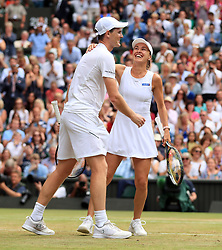 Martina Hingis and Jamie Murray during the mixed doubles final against Heather Watson and Henri Kontinen on day thirteen of the Wimbledon Championships at The All England Lawn Tennis and Croquet Club, Wimbledon.