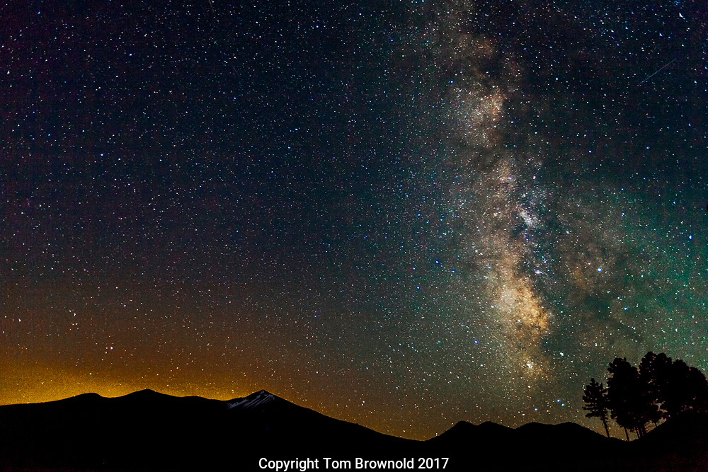 The North side of the San Francisco Peaks with the milky way. The peaks are haloed with the city of Flagstaff's light pollution.