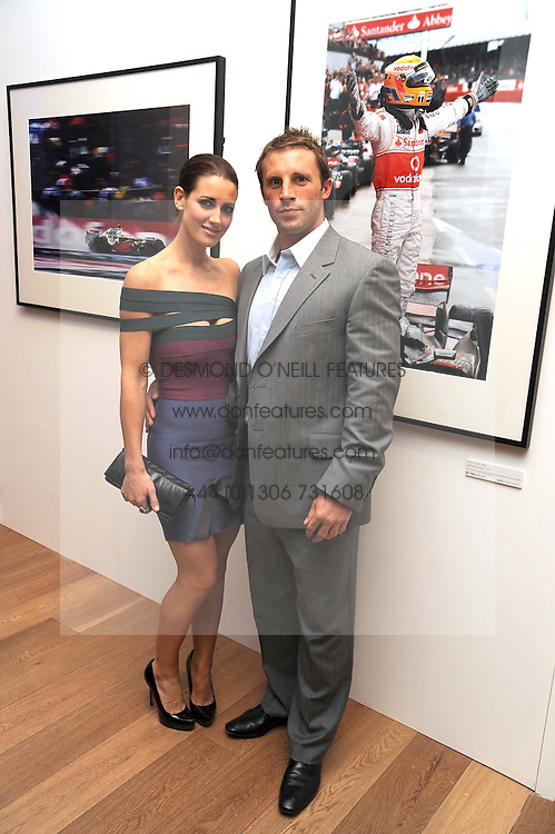 TV presenter KIRSTY GALLACHER and PAUL SAMPSON at the TAG Heuer British Formula 1 Party at the Mall Galleries, London on 15th September 2008.