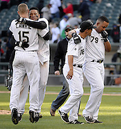CHICAGO - APRIL 23:  Melky Cabrera #53 and Brett Lawrie #15 hug each other while Jose Abreu #79 and Tyler Saladio #18 of the Chicago White Sox leave the field after Abreu hit a walk-off RBI single in the eleventh inning against the Texas Rangers on April 23, 2016 at U.S. Cellular Field in Chicago, Illinois.  The White Sox defeated the Rangers 4-3 in 11 innings.  (Photo by Ron Vesely)   Subject: Jose Abreu; Brett Lawrie; Melky Cabrera; Tyler Saladino