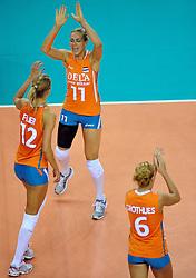 18-09-2011 VOLLEYBAL: DELA TROPHY NEDERLAND - TURKIJE: ALMERE<br /> Nederland wint met 3-0 van Turkije en wint hierdoor de DELA Trophy / (L-R) Captain Manon Flier, Caroline Wensink, Maret Grothues<br /> ©2011-FotoHoogendoorn.nl
