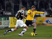 Photo: Chris Ratcliffe.<br /> Juventus v Arsenal. UEFA Champions League. Quarter-Finals. 05/04/2006. <br /> Alexander Hleb of Arsenal gets away from Giorgio Chiellini of Juventus