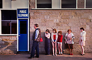 Waiting for the pay-phone, Butlins Holiday camp, Skegness. Butlins Skegness is a holiday camp located in Ingoldmells near Skegness in Lincolnshire. Sir William Butlin conceived of its creation based on his experiences at a Canadian summer camp in his youth and by observation of the actions of other holiday accommodation providers, both in seaside resort lodging houses and in earlier smaller holiday campsThe camp began opened in 1936, when it quickly proved to be a success with a need for expansion. The camp included dining and recreation facilities, such as dance halls and sports fields. Over the past 75 years the camp has seen continuous use and development, in the mid-1980s and again in the late 1990s being subject to substantial investment and redevelopment. In the late 1990s the site was re-branded as a holiday resort, and remains open today as one of three remaining Butlins resorts.