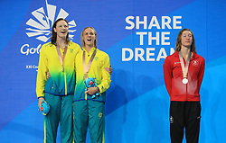 Australia's Bronte Campbell celebrates winning Gold with Australia's Cate Campbell who won Silver in the Women's 100m Freestyle Final alongside Canada's Taylor Ruck who won Bronze at the Gold Coast Aquatic Centre during day five of the 2018 Commonwealth Games in the Gold Coast, Australia. PRESS ASSOCIATION Photo. Picture date: Monday April 9, 2018. See PA story COMMONWEALTH Swimming. Photo credit should read: Mike Egerton/PA Wire. RESTRICTIONS: Editorial use only. No commercial use. No video emulation.