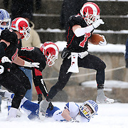 Alexander LaPolice, New Canaan, on his way to a touchdown past Hudson Hamill, Darien, during the New Canaan Rams Vs Darien Blue Wave, CIAC Football Championship Class L Final at Boyle Stadium, Stamford. The New Canaan Rams won the match in snowy conditions 44-12. Stamford,  Connecticut, USA. 14th December 2013. Photo Tim Clayton