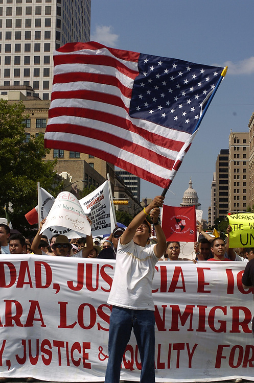 Austin, TX May 1, 2006: Thousands of immigrants and immigrant rights supporters march down Congress Avenue in downtown Austin Monday, part of a show of solidarity nationwide and protesting political reforms working their way through the U.S. Congress. National Day Without Immigrants protest and boycott. ©Bob Daemmrich