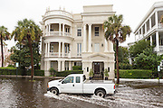A truck passes stately homes in floodwater along the Battery in the historic district as Hurricane Joaquin brings heavy rain, flooding and strong winds as it passes offshore October 4, 2015 in Charleston, South Carolina.