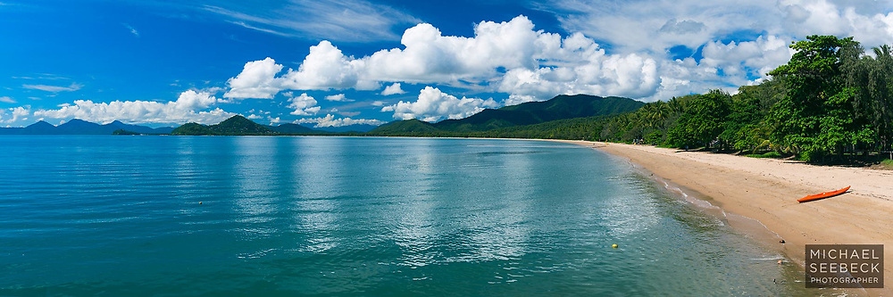 A beautiful day on Palm Cove Beach in Summer. Flat conditions and fluffy cumulus clouds developing over the coastal range...<br /> <br /> Open Edition Print & Available as a Stock Image