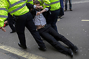 An environmental activist is dragged and arrested while protesting about Climate Change during the blockade of Whitehall in central London, part of a two-week prolonged worldwide protest by members of Extinction Rebellion, on 16th October 2019, in Westminster, London, England.