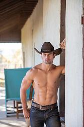 shirtless cowboy on a porch