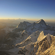 Sunrise from just below the South Summit on Everest's Southeast Ridge, looking east at the peaks of Makalu, Chomolhunzo, and distant Kangchenjunga.