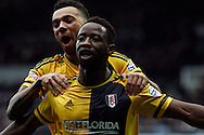 Moussa Dembele of Fulham celebrating with Ryan Fredericks after scoring the second goal of the game to make it 0-2..  Skybet football league championship match, Queens Park Rangers v Fulham at Loftus Road Stadium in London on Saturday 13th February 2016.<br /> pic by Steffan Bowen, Andrew Orchard sports photography.