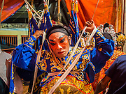 16 JANUARY 2015 - BANGKOK, THAILAND: Performers with the Sai Yong Hong Opera Troupe finish putting on their costumes backstage at the Chaomae Thapthim Shrine, a Chinese shrine in a working class neighborhood of Bangkok near the Chulalongkorn University campus. The troupe's nine night performance at the shrine is an annual tradition and is the start of the Lunar New Year celebrations in the neighborhood. Lunar New Year, also called Chinese New Year, is officially February 19 this year. Teochew opera is a form of Chinese opera that is popular in Thailand and Malaysia.    PHOTO BY JACK KURTZ