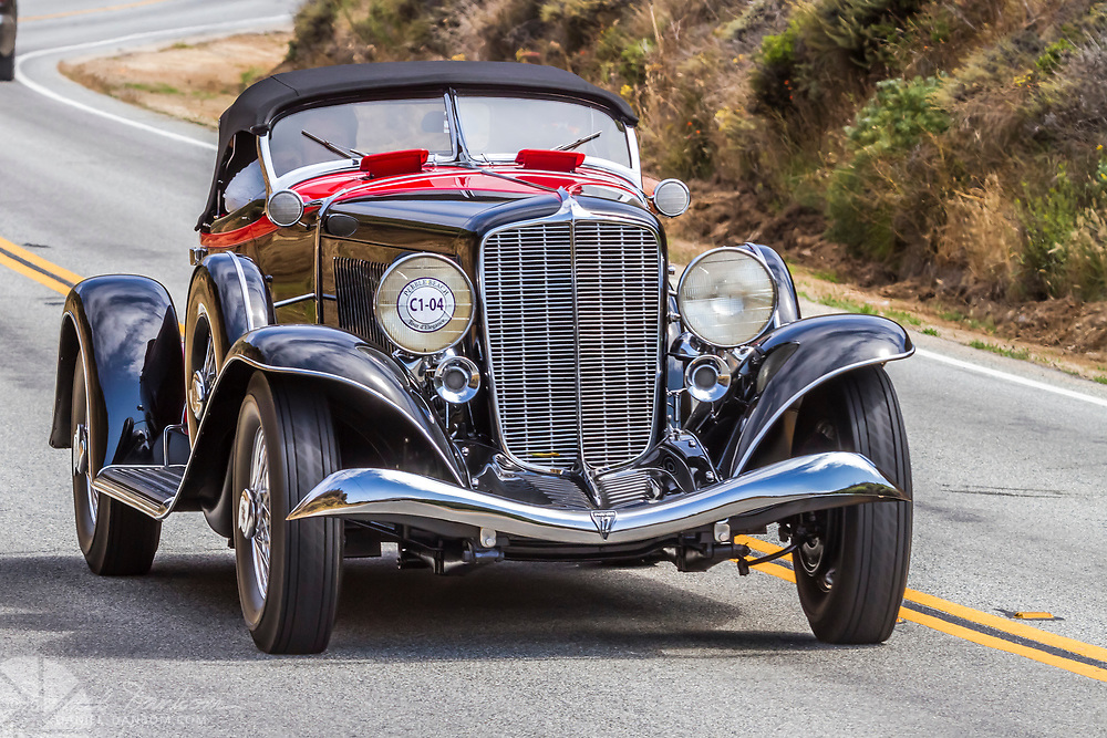 933 Auburn 12-165 Speedster on theTour d Elegance, along Highway 1 on the Big Sur Coast. Classic and Historic autos participate in the Pebble Beach, Concours d Elegance, take to the highway to tour the Monterey Peninsula and coast.