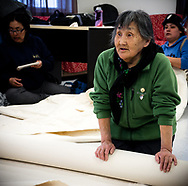 Mary K. Inukpuk is teaching a group of women how to sew a tent.