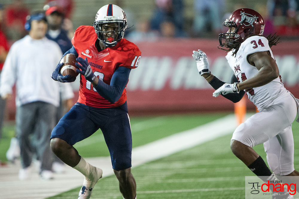 MOBILE, AL - OCTOBER 24: Wide receiver Danny Woodson #18 of the South Alabama Jaguars looks to maneuver by cornerback Ethan Davis #34 of the Troy Trojans on October 24, 2014 at Ladd-Peebles Stadium in Mobile, Alabama.  The South Alabama Jaguars defeated the Troy Trojans 27-13. (Photo by Michael Chang/Getty Images) *** Local Caption *** Danny Woodson; Ethan Davis
