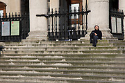 Man sleeping on the steps of St Martin-in-the-Fields church, which is almost deserted due to the Covid-19 outbreak social distancing on what would normally be a busy, bustling day with hoards of people hanging out and socialising on 22nd March 2020 in London, England, United Kingdom. Coronavirus or Covid-19 is a new respiratory illness that has not previously been seen in humans. While much or Europe has been placed into lockdown, the UK government has announced more stringent rules as part of their long term strategy, and in particular social distancing.