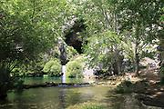 Stream resurgence from limestone cave, Cueva del Gato, Benaojan, Serrania de Ronda, Malaga province, Spain