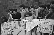Michael Dukakis, the Governor of the State of Massachusetts, was the Democratic candidate for the President of the United States in the 1988 election. This set of photographs is from his campaign appearances, speeches, and strategy sessions during the New York and California primaries.<br /> <br /> University of Rochester students listening to Dukakis' speech.