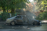 The burnt out shell of a Mercedes-Benz at Denmark Hill on the 14th May 2019 in London in the United Kingdom.