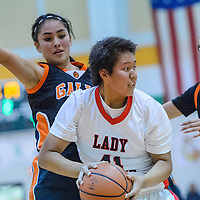 Crownpoint Eagle Tia Charley (41) searches for an opening around Gallup JV Bengals Ashley Antone (32) and Journey Gilson (23) Friday at Wingate High School.