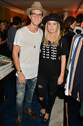 OLLIE PROUDLOCK and MARISSA MONTGOMERY  at a party to celebrate the launch of Baar & Bass, 336 Kings Road, London on 9th September 2014.