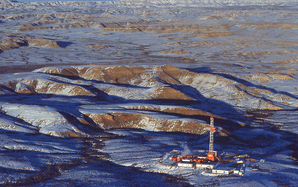 Stock photo of the aerial view of an on-shore drilling site in the snow
