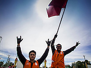 17 MAY 2014 - BANGKOK, THAILAND: Motorcycle taxi drivers who support the Red Shirts rally on Aksa Road in Bangkok. Thousands of Thai Red Shirts, members of the United Front for Democracy Against Dictatorship (UDD), members of the ruling Pheu Thai party and supporters of the government of ousted Prime Minister Yingluck Shinawatra are rallying on Aksa Road in the Bangkok suburbs. The government was ousted by a court ruling earlier in the week that deposed Yingluck because the judges said she acted unconstitutionally in a personnel matter early in her administration. Thailand now has no functioning government. Red Shirt leaders said at the rally Saturday that any attempt to impose an unelected government on Thailand could spark a civil war. This is the third consecutive popularly elected UDD supported government ousted by the courts in less than 10 years.    PHOTO BY JACK KURTZ