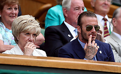 David and mum Sandra Beckham in the royal box of centre court on day five of the Wimbledon Championships at The All England Lawn Tennis and Croquet Club, Wimbledon.