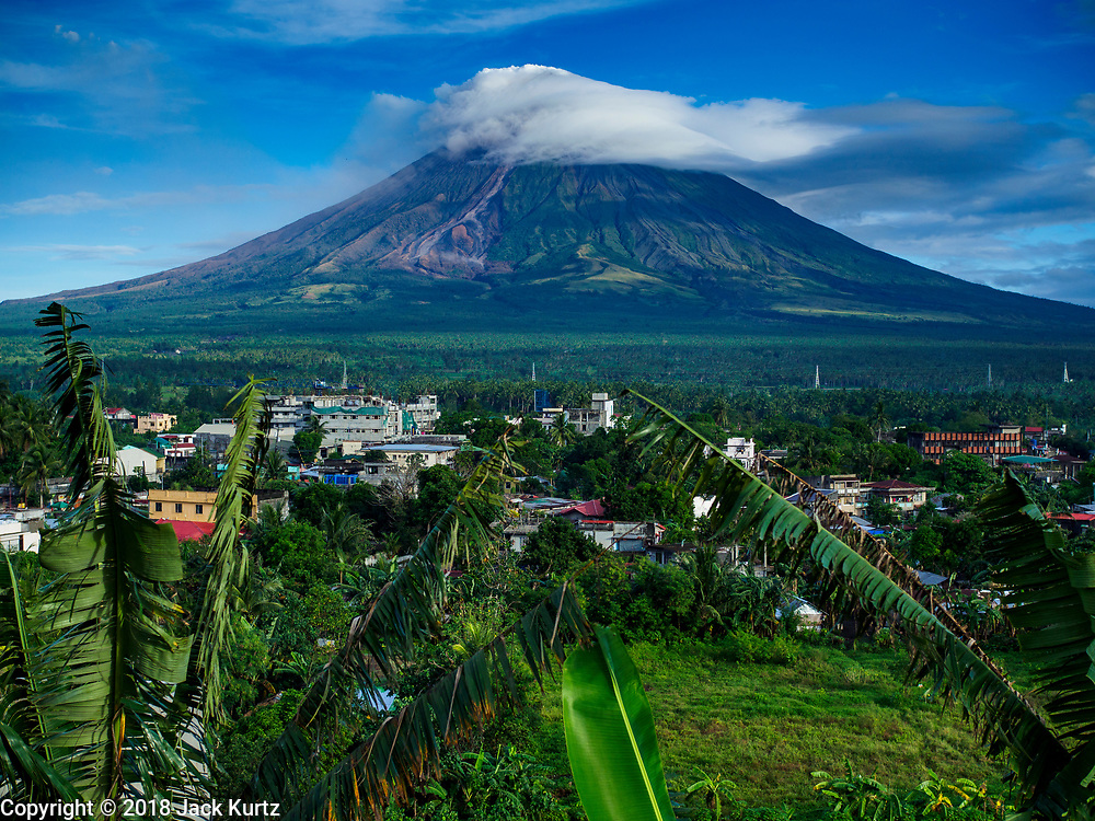 21 JANUARY 2018 - LEGAZPI, ALBAY, PHILIPPINES:  The Mayon volcano, as seen from Our Lady of the Gate Parish (Parroquia Nuestra Señora de la Porteria), releases smokes and ash Sunday morning. Mayon is the most active volcano in the Philippines. More than 30,000 people have been evacuated from communities on the near the Mayon volcano in Albay province in the Philippines. Most of the evacuees are staying at schools in communities outside of the evacuation zone.PHOTO BY JACK KURTZ