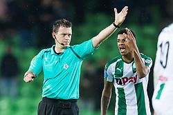(L-R) referee Allard Lindhout, Juninho Bacuna of FC Groningen during the Dutch Eredivisie match between FC Groningen and Willem II Tilburg at Noordlease stadium on October 20, 2017 in Groningen, The Netherlands