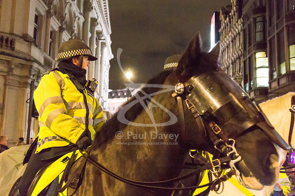 London, December 31 2017. A mounted police officer on Shaftesbury Avenue as revellers in London's West End enjoy the build-up to New Year. © SWNS
