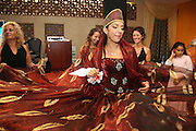 The bride in traditional Moroccan dress at the Henna celebration, Israel <br /> The Hina, also Henna, ceremony proceeds the wedding day. In this festive ceremony, natural red dye is applied on the hands of the participants especially the bride and groom, to symbolize happiness, wealth and a successful union of the young couple.