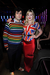 EMERALD FENNELL and CHRIS VERNON at the Tatler Little Black Book Party held at Chinawhite, 4 Winsley Street, London on 20th November 2009.