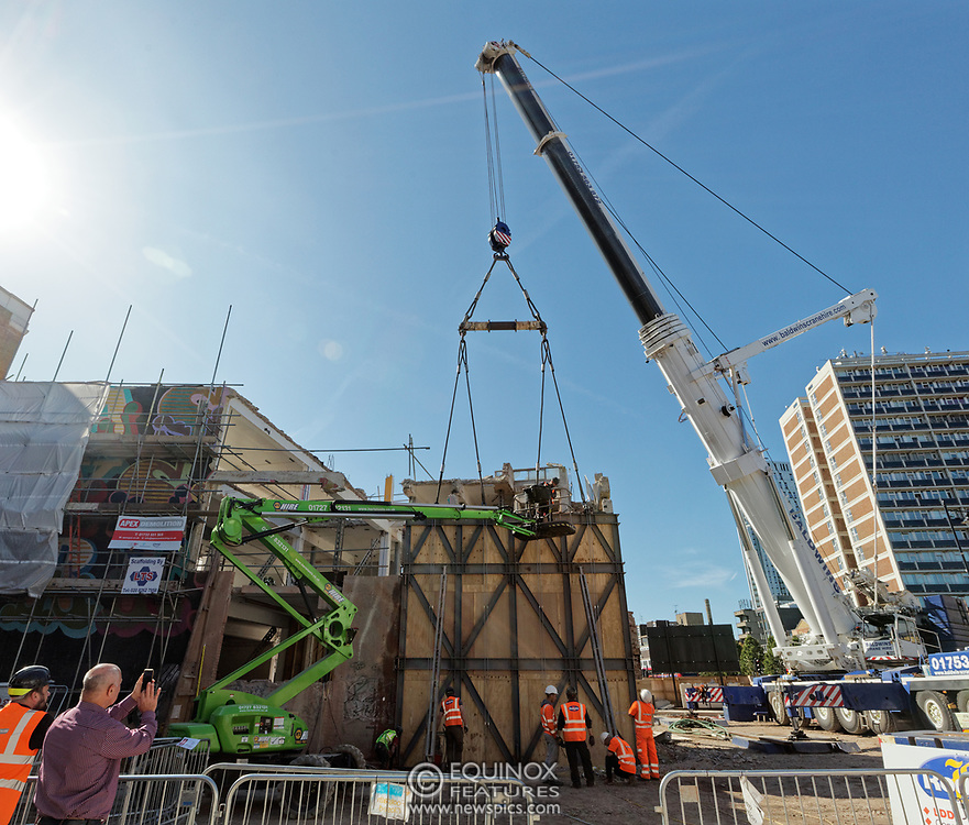 London, United Kingdom - 20 September 2019<br /> EXCLUSIVE SET - Aerial construction specialists and demolition experts use a huge crane to carefully lift intact, a twenty five ton, two-story wall, to preserve a famous Banksy rat image which has been covered up for years. Teams from specialist companies have spent over six weeks cutting around the artwork and fitting custom made eight ton steel supports to enable them to save the historic piece of art. Work has started on the construction of a new twenty seven floor art'otel hotel on the site of the old Foundry building in Shoreditch, east London, and a condition of the planning permission was to preserve the historical Banksy graffiti. A second section of the painting, an image of a TV being thrown through a broken window has already been cut out and moved separately. After the hotel construction is complete the two parts of the Banksy painting will be displayed on the hotel. Our pictures show the stages of work to protect the image, culminating in the lifting of the three story wall by crane. Video footage also available.<br /> (photo by: EQUINOXFEATURES.COM)<br /> Picture Data:<br /> Photographer: Equinox Features<br /> Copyright: ©2019 Equinox Licensing Ltd. +443700 780000<br /> Contact: Equinox Features<br /> Date Taken: 20190920<br /> Time Taken: 14145931<br /> www.newspics.com