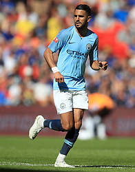 """Manchester City's Riyad Mahrez during the Community Shield match at Wembley Stadium, London. PRESS ASSOCIATION Photo. Picture date: Sunday August 5, 2018. See PA story SOCCER Community Shield. Photo credit should read: Adam Davy/PA Wire. RESTRICTIONS: EDITORIAL USE ONLY No use with unauthorised audio, video, data, fixture lists, club/league logos or """"live"""" services. Online in-match use limited to 75 images, no video emulation. No use in betting, games or single club/league/player publications."""
