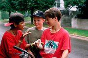 Friends age 12 and 14 explaining circumstances for broken wrist.  St Paul  Minnesota USA