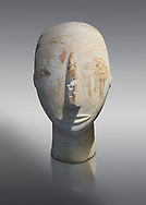 Head of a Cycladic statue with remnants of painted eyes and right cheek, Parian Marble, Amorgos, Early Cycladic II period (2800-3200BC). National Archaeological Museum, Athens.   Grey background. .<br /> <br /> If you prefer to buy from our ALAMY PHOTO LIBRARY  Collection visit : https://www.alamy.com/portfolio/paul-williams-funkystock/cycladic-art-artefacts.html Type into the LOWER SEARCH WITHIN GALLERY box to refine search by adding background colour, place, museum etc<br /> <br /> Visit our CYCLADIC CIVILISATIONS PHOTO COLLECTIONS for more photos to download or buy as wall art prints https://funkystock.photoshelter.com/gallery-collection/Cycladic-civilisation-Ancient-Greek-Artefacts-art-Photos-Pictures-Images/C0000CmevVvnC.XU