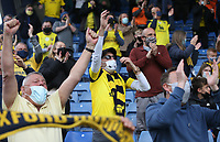 Oxford United fans<br /> <br /> Photographer Rob Newell/CameraSport<br /> <br /> Sky Bet League One Play-Off Semi-Final 1st Leg - Oxford United v Blackpool - Tuesday 18th May 2021 - Kassam Stadium - Oxford<br /> <br /> World Copyright © 2021 CameraSport. All rights reserved. 43 Linden Ave. Countesthorpe. Leicester. England. LE8 5PG - Tel: +44 (0) 116 277 4147 - admin@camerasport.com - www.camerasport.com